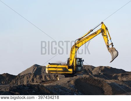 Excavator Working On Earthmoving At Open Pit Mining. Backhoe Digs Gravel In Quarry. Construction Equ