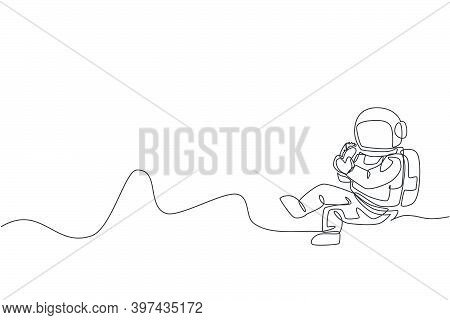 Single Continuous Line Drawing Of Spaceman Sitting Relax On Moon Surface And Eating Delicious Mexica