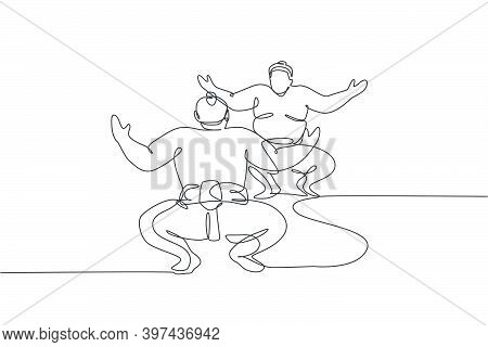 One Continuous Line Drawing Of Two Young Big Japanese Rikishi Men Prepare To Fight At Festival Tourn
