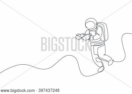 Single Continuous Line Drawing Of Floating Science Astronaut In Spacewalk Reading Space Map. Fantasy