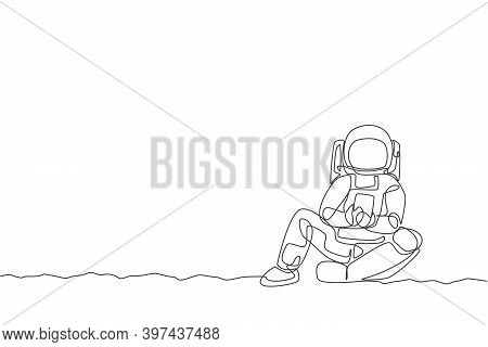 One Continuous Line Drawing Of Young Spaceman On Spacesuit Siting Relax On Moon Surface While Textin