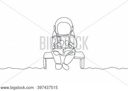 Single Continuous Line Drawing Of Astronaut Siting Relax On Chair While Reading News In Tablet Phone