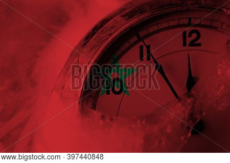 Morocco, Moroccan Flag With Clock Close To Midnight In The Background. Happy New Year Concept