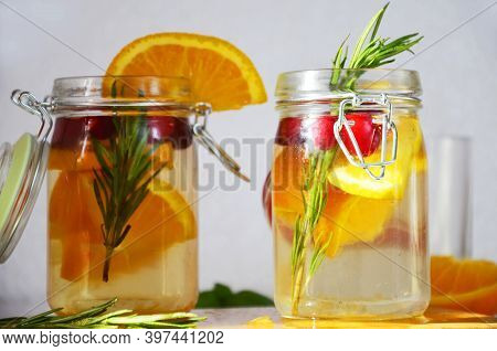Detox Water With Orange, Cranberry And Rosemary, Healthy Drink For The Diet, Vitamin C. Festive Cran