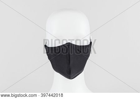 Black protective fabric face mask on a mannequin