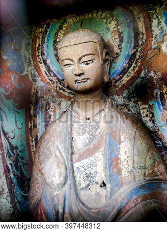 Colorful Statue Of A Buddhist Follower In Gansu, China
