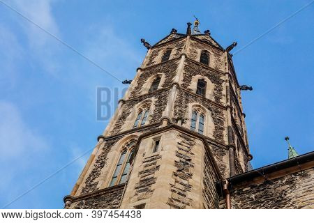 Low Angle View At A Part Of Medieval Stone St. Bartholomew´s Church In Autumn Day, Arched Windows, C