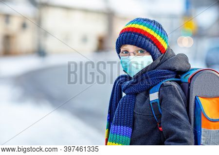 School Kid Boy With Glasses Wearing Medical Mask On The Way To School. Child Backpack Satchel. Schoo