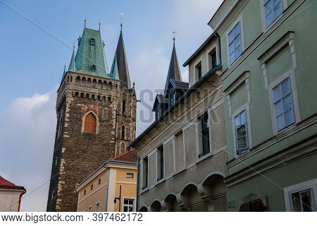 Medieval Stone St. Bartholomew´s Church With Belfry Tower, Gothic Cathedral At The End Of Narrow Str