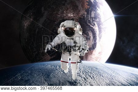 Astronaut In Outer Space In Planetary Orbit. Inhabited Planet In Deep Space. Science Fiction. Elemen