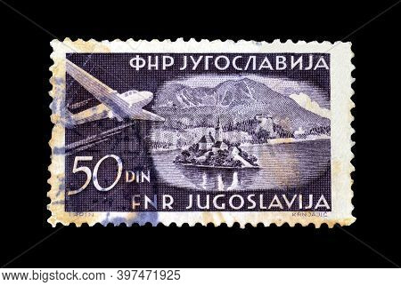 Yugoslavia - Circa 1951 : Cancelled Postage Stamp Printed By Yugoslavia, That Shows Airplane Over Is