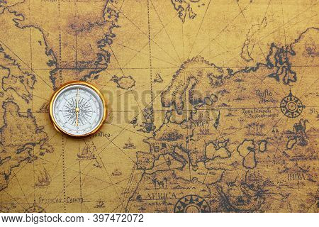 Classic Round Compass On Old Vintage Map Depicting North America And The United States Of America As