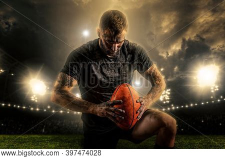 Rugby player in action on stadium background. Sports banner