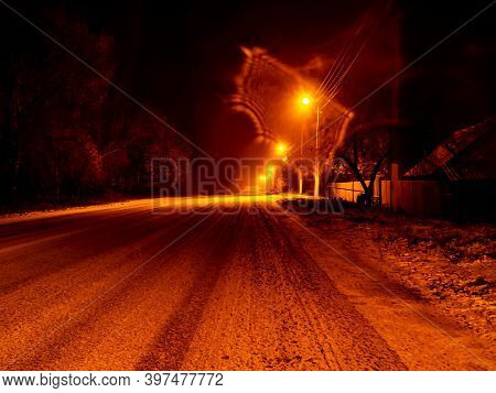 Night Winter Snowy Road For Cars In The Light Of Lanterns. Snow On A Country Road. Street Lights. Wi