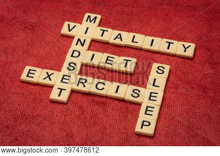 vitality, mindset, exercise, diet and sleep crossword in ivory letter tiles against textured handmade paper, healthy lifestyle concept
