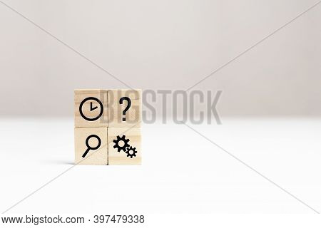 Magnifier, Question Mark, Clock, Gears Symbols On Wooden Cubes On White Table, Copy Space. Developme