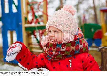 Winter Girl Throwing Snowball At Camera Smiling Happy Having Fun Outdoors On Snowing Winter Day Play