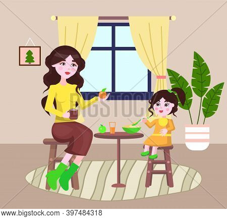 Young Mother Feeding Her Small Daughter Sitting At Table. Little Girl Holding Spoon With Meal Above