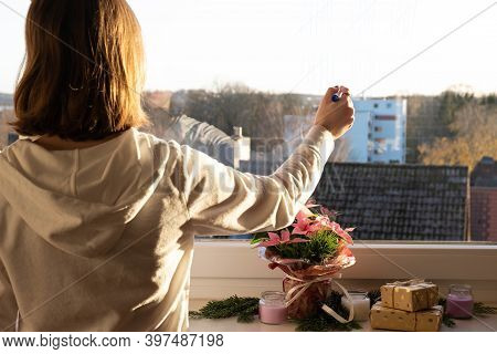 The Girl Writes On The Glass Of The Window, Counts The Days In Quarantine