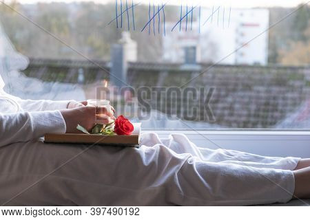 The Girl Sits On The Windowsill, Thinks And Is Bored