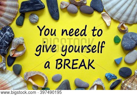 Time To Break. Text 'you Need To Give Yourself A Break' On A Beautiful Yellow Background. Sea Stones