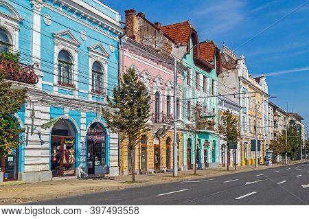 Cluj-napoca, Transylvania, Romania - September 20, 2020: Houses With Multicolored Facades Located In