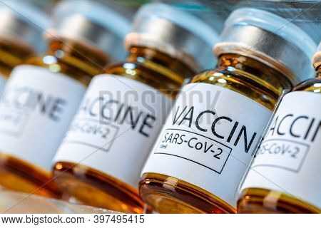 Vaccine Vials Of Sars-cov-2 On Table In Laboratory .