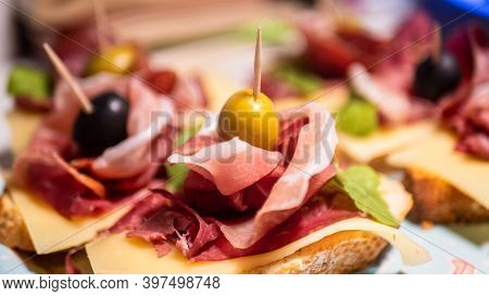Traditional Spanish Ham Jamon Serrano, Prosciutto Crudo, Parma Ham, Italian Antipasto, Served On Toa
