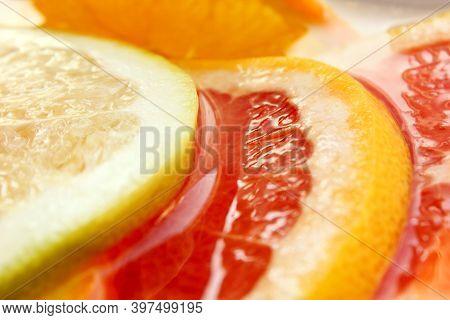 Grapefruit, Orange, Lime, Tangerine, Lemon Slices In Water. Background Is Made Of Citrus Fruits. Pie