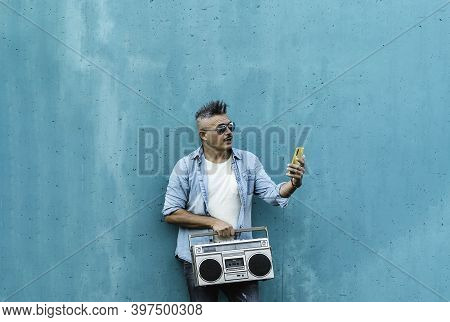 Mature Cool Man Video Calling While Listening Music With A Vintage Boombox Tape Player - Indie Guy H