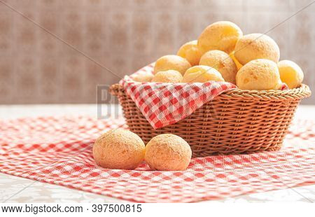 Cheese Bread From Brazil. Cheese Bread On A Table With Red And White Checked Tablecloth, Selective F