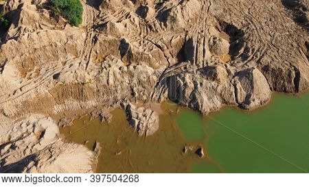 Flooded Sand Quarry. Place Where Dirt Bikes Ride And Leave Traces. Landscape For Extreme Quadricycle