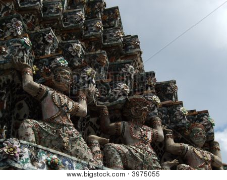 Yaksha at the base of central prang of Wat Arunratchawararam Bangkok Thailand poster