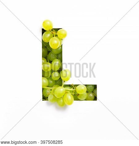 Letter L Of English Alphabet Of Green Grape And Cut Paper Isolated On White. Appetizing Typeface Mad