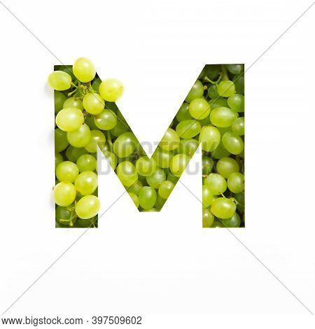 Letter M Of English Alphabet Of Fresh Grape And Cut Paper Isolated On White. Typeface Of Green Berri