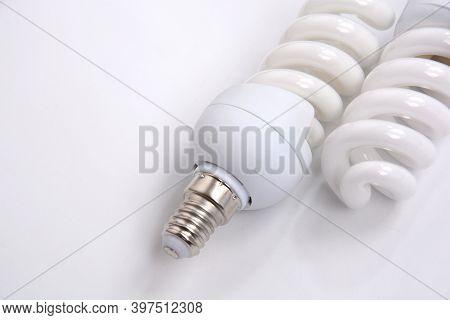 Fluorescent Lightbulbs. Two Compact Fluorescent Light Bulb Over White Background.