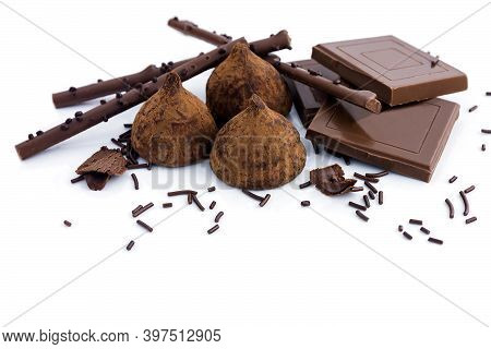 Chocolate Delicious Dessert In The Form Of Sweets, Chocolate Pieces, Crispy Sticks On An Isolated Wh