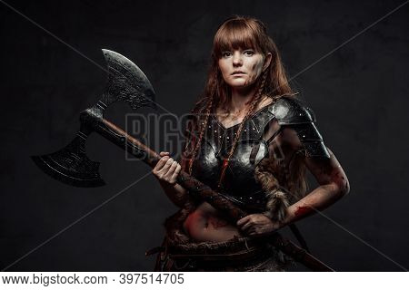 Brown Haired Grimy Amazon From Nord Holding Two Handed Axe And Dressed In Dark Armour Posing In Dark