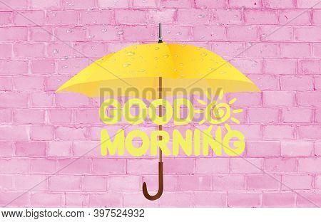 Good Morning. The Inscription Good Morning On A Pink Brick Background. Yellow Umbrella.