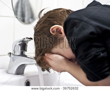 Young Boy Washing His Face