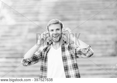 Falling In Love With My Headphones. Happy Guy Wear Headphones Outdoors. Handsome Man Listen To Music