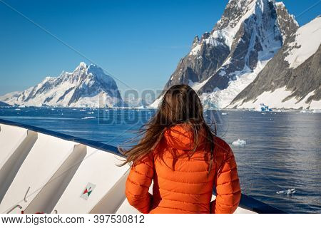 A Girl Stands On The Prow Of A Passenger Ship Near The  Lemaire Channe In Antarctica. Close Up.