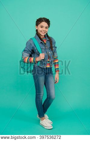 Happy Child With Long Hair Plaits Carry Travel Bag Wearing Casual Streetwear Blue Background, Fashio