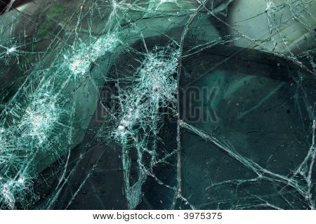 close-up image of a shattered auto windshield poster