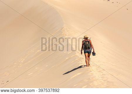 Sotovento, Fuerteventura, Spain: 2020 October 8: Young Blonde Woman Walks Through The Dunes At Playa