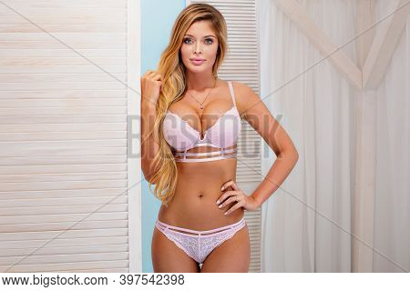 Portrait Of Beautiful Sexy Blonde Girl With Long Hair And Tanned Body Wearing Lingerie, Sensual Posi