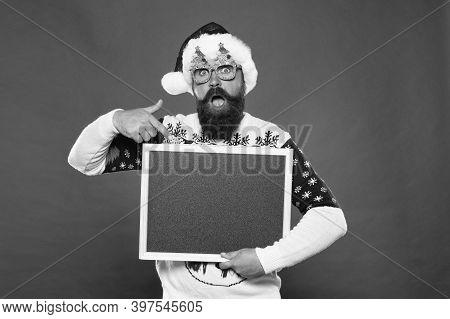 Let This Surprise You. Surprised Santa Point Finger At Blackboard. Bearded Man Prepare Surprise Part