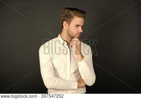 Fashion Barber. Serious Man Touch Beard Dark Background. Beard Barber. Handsome Guy With Unshaven Fa