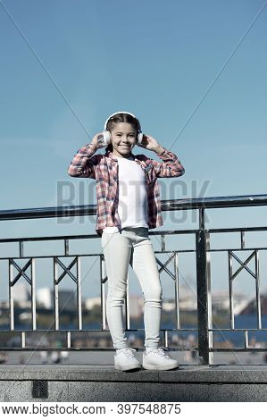 Discovering New Music Styles Is Great Way Into Culture. Girl Child Listen Music Outdoors With Modern