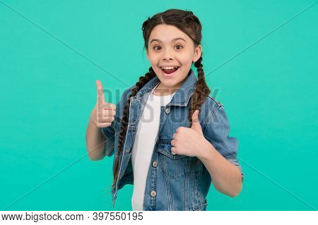 Best Version Of You. Happy Kid Give Thumbs Ups Blue Background. Little Girl Smile Gesturing Thumbs U
